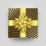 Christmas gift box or present with golden ribbon bow and gold foil wrapping paper. Christmas gift box or present with golden ribbon bow and gold foil wrapping Royalty Free Stock Photos
