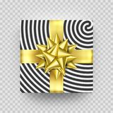 Christmas gift box or present with golden ribbon bow and wrapping paper stripe pattern. Christmas gift box or present with golden ribbon bow and wrapping paper Stock Photos
