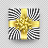 Christmas gift box or present with golden ribbon bow and wrapping paper stripe pattern. Christmas gift box or present with golden ribbon bow and wrapping paper Royalty Free Stock Images