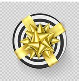 Christmas gift box or present with golden ribbon bow and wrapping paper stripe pattern.. Christmas gift box or present with golden ribbon bow and wrapping Royalty Free Stock Image