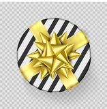 Christmas gift box or present with golden ribbon bow and wrapping paper stripe pattern. Round Christmas gift box  on trans. Parent background for New Year Royalty Free Stock Images