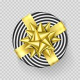 Christmas gift box or present with golden ribbon bow and wrapping paper stripe pattern. Christmas gift box or present with golden ribbon bow and wrapping paper Royalty Free Stock Photo