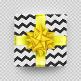 Christmas gift box or present with golden ribbon bow and wrapping paper zigzag pattern. Vector Christmas gift box  on tran. Sparent background for New Year Stock Images