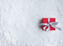 Christmas gift box,present on snow background.For christmas. Concepts or new year,celebration ideas.Top view stock photos
