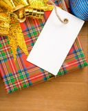 Christmas gift box and price tag near balls Stock Photography