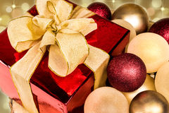 Christmas Gift Box, Red and Gold Baubles decoration Stock Photography