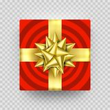 Christmas gift box red present in golden ribbon bow and wrapping paper wave pattern.. Christmas gift box red present in golden ribbon bow and wrapping paper Royalty Free Stock Photography
