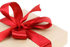 Christmas gift box with red ribbon closeup Stock Photos