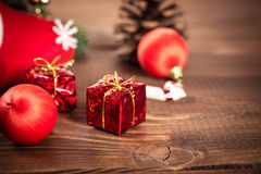 Christmas gift box with red ribbon on dark wooden background Royalty Free Stock Photography