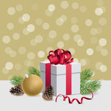 Christmas gift box with red ribbon and decoration ball on golden. Christmas gift box with red ribbon and christmas decorations Stock Photography
