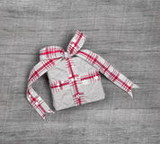 Christmas gift box with ribbon on grey wooden background Royalty Free Stock Photography