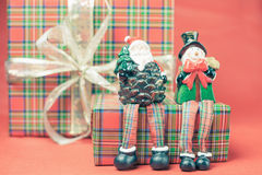 Christmas gift box with Santa Claus and snowman toy Stock Images
