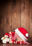 Christmas gift box with santa hat and snowman Royalty Free Stock Photography