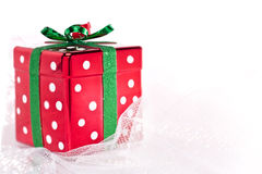 Christmas gift box on shimmery fabric Royalty Free Stock Photos