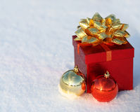 Christmas Gift Box with Shiny Balls on Snow. Outside. Winter Sunny Day stock image