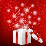 Christmas gift box with shiny snowflakes Royalty Free Stock Image