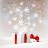 Christmas gift box with shiny snowflakes Royalty Free Stock Photo