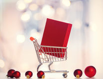 Christmas gift box and shopping cart Stock Image