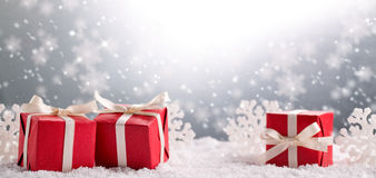 Christmas gift box on snow Stock Images