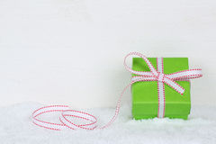 Christmas gift box with snow and copyspace Royalty Free Stock Image