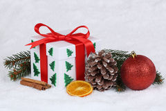 Christmas gift box with snow Stock Photos