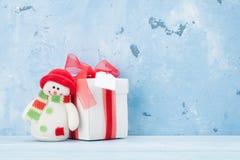 Christmas gift box and snowman Stock Photos