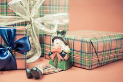 Christmas gift box with snowman toy at red background Stock Photos