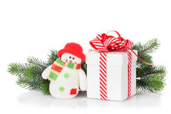 Christmas gift box, snowman and tree branch Royalty Free Stock Photography