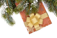 Christmas gift box and snowy fir tree Royalty Free Stock Photography