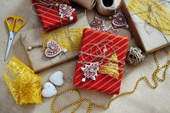 Christmas gift box with string stars hearts and other decorations Royalty Free Stock Photography