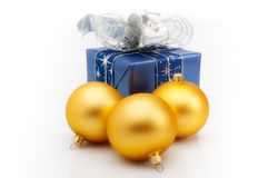 Christmas gift box with three gold christmas balls. On white background. Horizontal Stock Photos