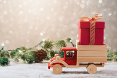 Christmas gift box on toy truck. Over festive background. Christmas holiday celebration concept stock photo