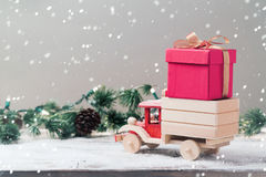 Christmas gift box on toy truck. Over festive background. Christmas holiday celebration concept royalty free stock photography