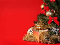 Christmas. Gift Box under Christmas Tree over Red Background Stock Image