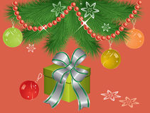 Christmas gift box under fir tree branches Stock Images