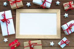 Christmas gift box and whiteboard on wood background Stock Photo