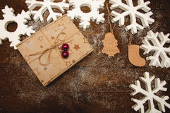 Christmas gift box with wood figure Royalty Free Stock Photo