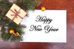 Christmas gift box on a wooden desktop with letter for copy space. Royalty Free Stock Photos