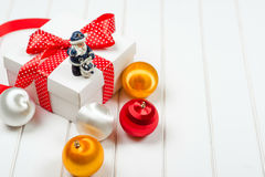 Christmas gift box on wooden white backround. Winter holidays concept. Stock Images