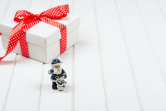 Christmas gift box on wooden white backround. Winter holidays concept. Royalty Free Stock Image