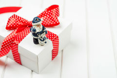 Christmas gift box on wooden white backround. Winter holidays concept. Stock Photography