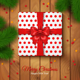 Christmas Gift Box Wrapping with Red Bow and Polka Dot Paper. Vector Illustration. Confetti. Wooden Floor Background. Present under Christmas Tree. Spruce Royalty Free Stock Images