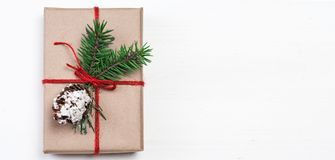Christmas gift box with xmas decorations as greeting card. Festi. Ve boxes of Christmas present with ribbon bow and fir tree branch on white background Royalty Free Stock Photography