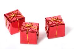 Christmas gift boxes. 3 Isolated red Christmas gift boxes royalty free stock photos
