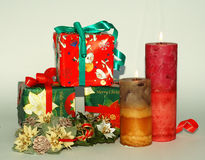 Christmas gift boxes. And two candles Stock Photography