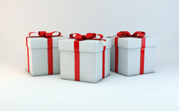 CHRISTMAS GIFT BOXES. Tree isolated Christmas gift boxes with red ribbon Stock Photo
