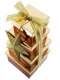 Christmas Gift Boxes. Stacked and tied with a ribbon, isolated on a white background Stock Photography