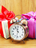 Christmas gift boxes and alarm clock Stock Photography