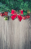 Christmas gift boxes and balls background on wooden texture Royalty Free Stock Photography