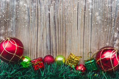 Christmas gift boxes and balls background on wooden texture Royalty Free Stock Photo
